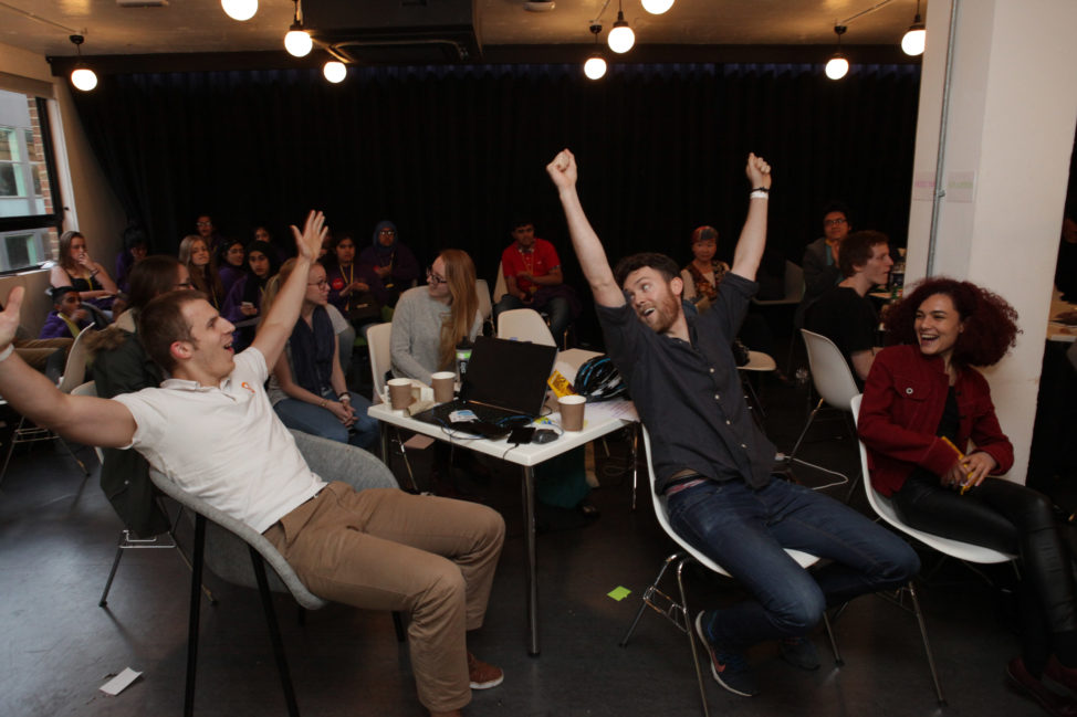 The winning team at Peacehack 2016 celebrate after their plugin, ;'Hate Speech Blocker' was announced the winner, in London, England. (International Alert)