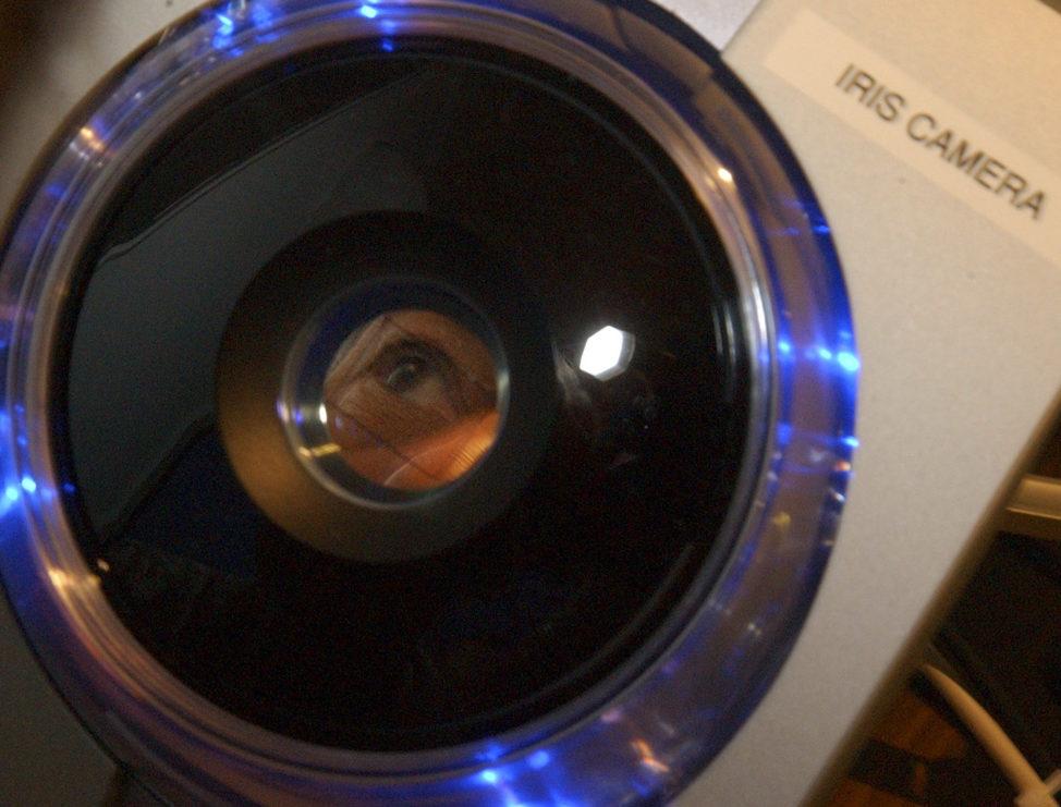 FILE - Jim Kaplan, of Weston, Mass., has his iris scanned at Logan Airport in Boston. (AP)