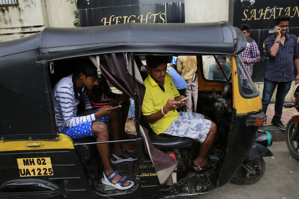 FILE - Indians play 'Pokémon GO' inside an autorickshaw in Mumbai, July 24, 2016. (AP)