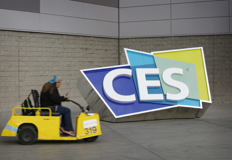FILE - A worker drives by a sign at the Las Vegas Convention Center before the start of the International CES gadget show, Jan. 3, 2016, in Las Vegas. (AP)