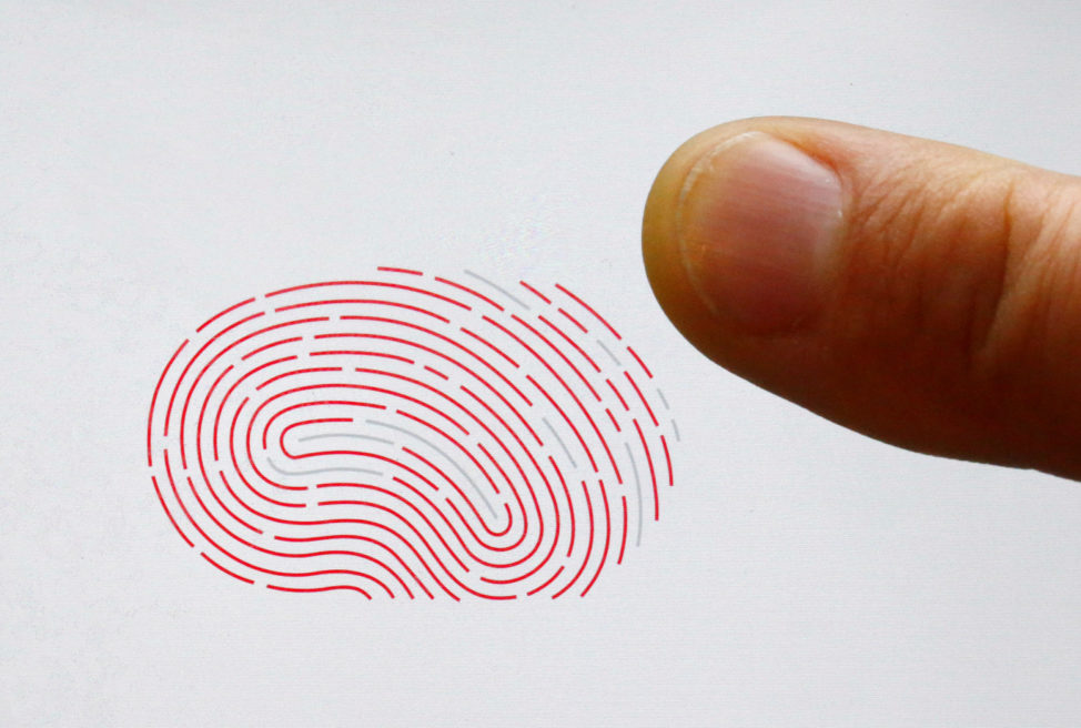 FILE - A person uses a sensor for biometric identification on a smartphone in Berlin, Germany Oct. 16, 2015.