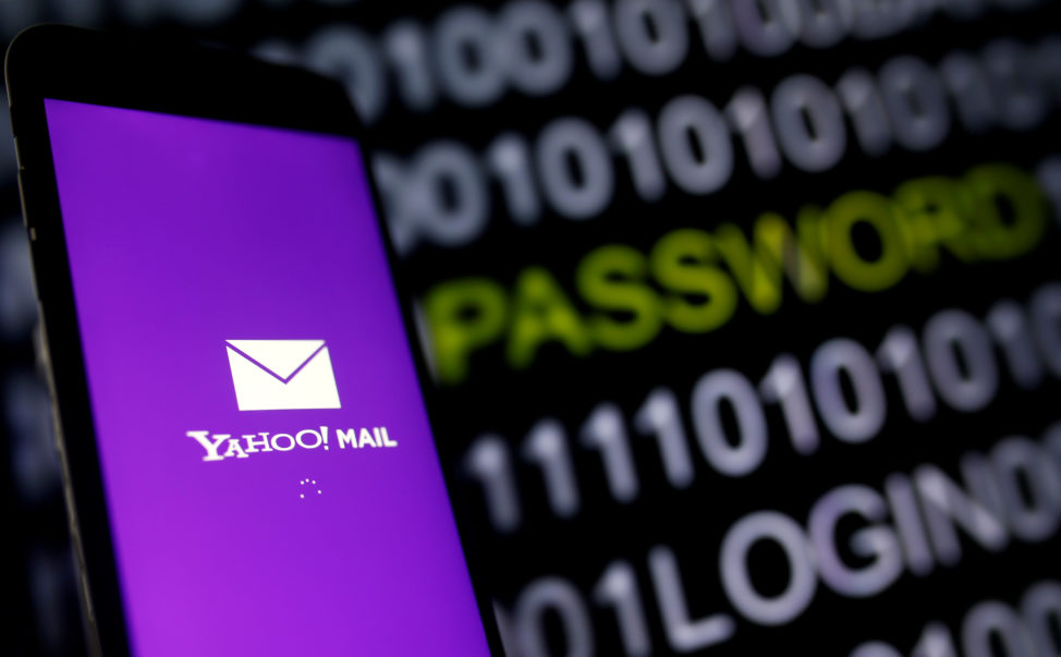Yahoo Mail logo is displayed on a smartphone's screen in front of code in this illustration picture, Oct. 6, 2016. (Reuters)