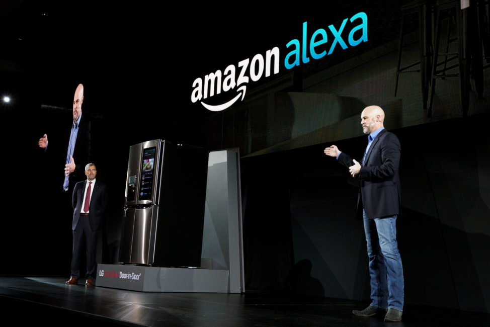 David VanderWaal, VP of marketing for LG Electronics USA (L), listens to Mike George, VP Alexa, Echo and Appstore for Amazon, talking about their companies' partnership to bring Amazon's digital assistant Alexa to LG appliances, during the LG press conference at the Consumer Electronics Show in Las Vegas, Jan. 4, 2017. (Reuters)