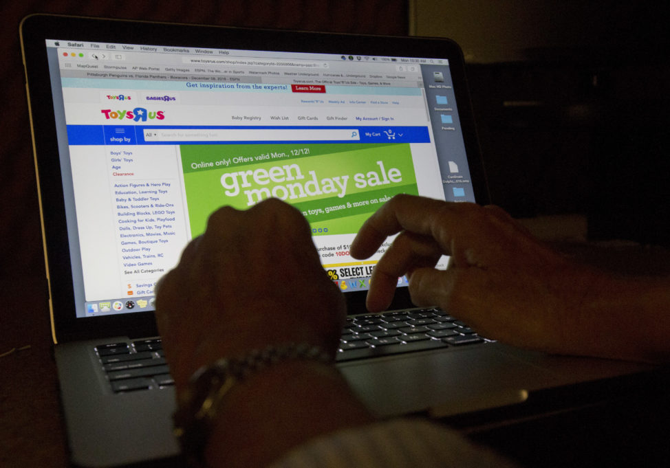 FILE - An online user searches different sites as he shops online. (AP)
