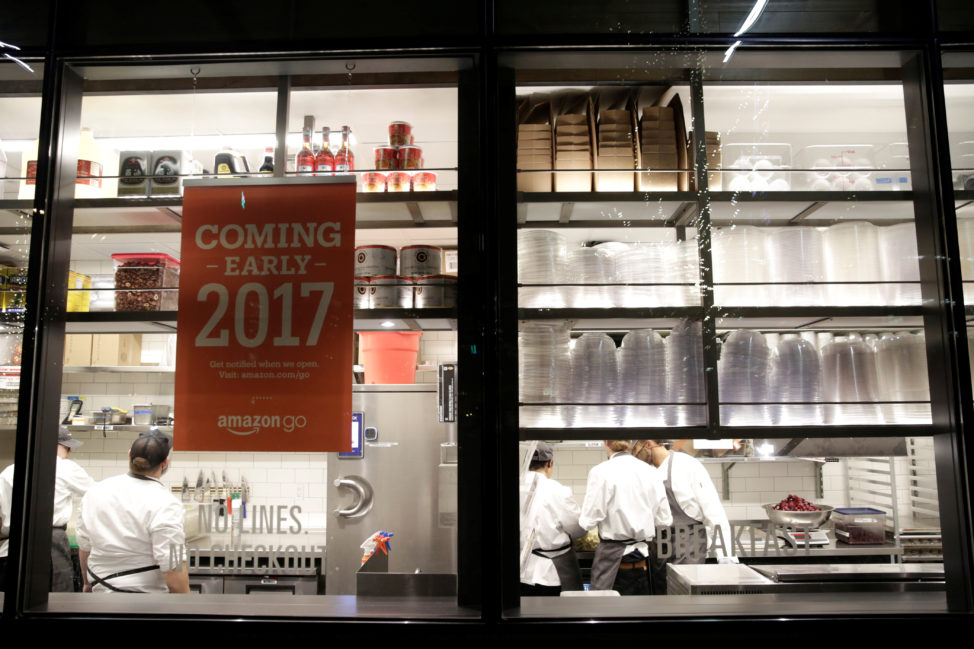 FILE - Kitchen staff are seen inside Amazon Go's brick-and-mortar grocery store without lines or checkout counters, in Seattle Washington, Dec. 5, 2016. (Reuters)