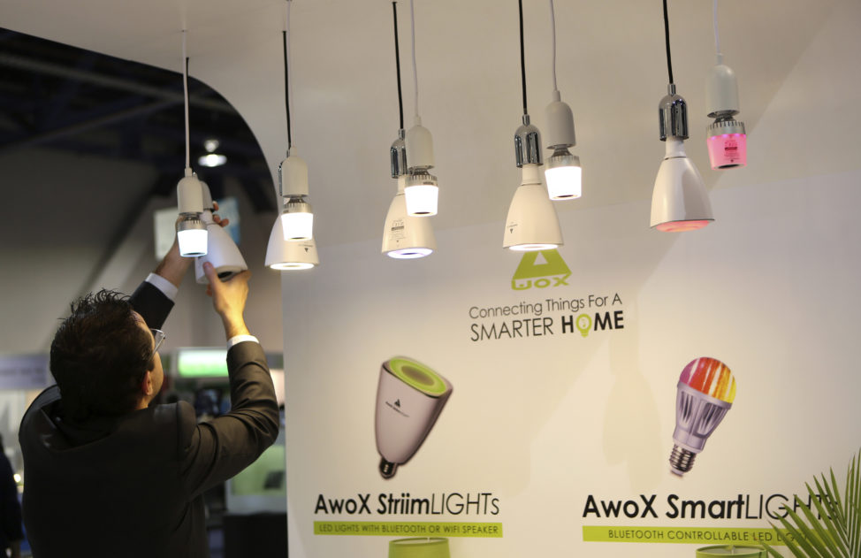 FILE - A man changes a bulb in Awox Smart Lights, which features a Bluetooth controllable LED light, in Las Vegas, Nevada. (Reuters)