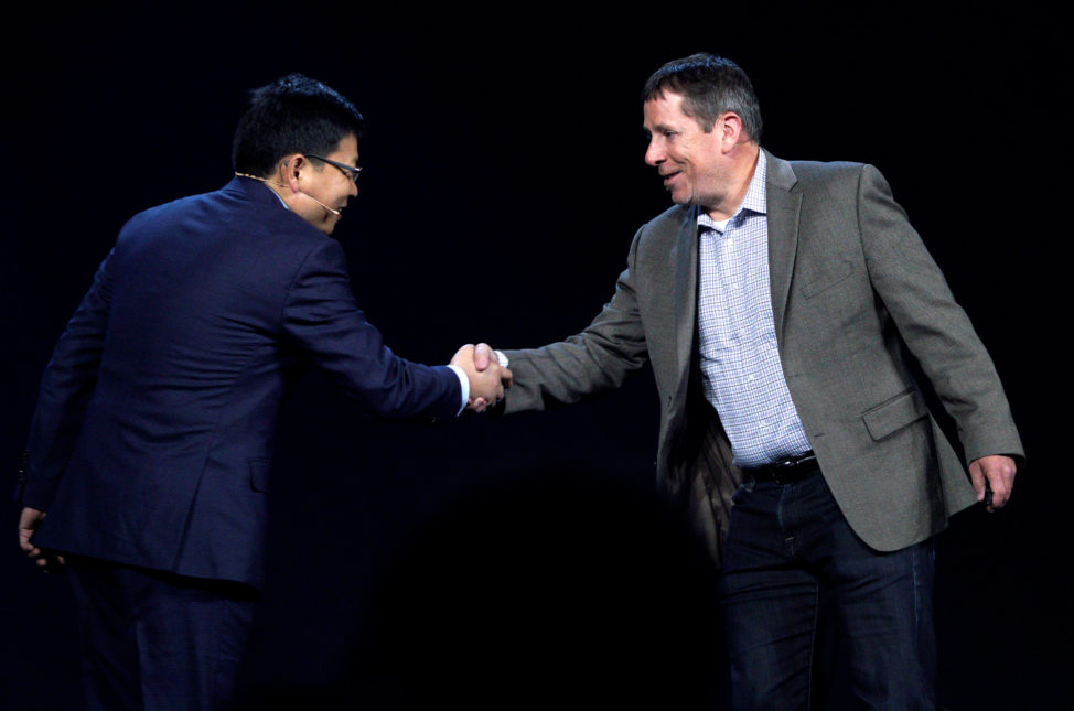 Steve Rabuchin, Amazon president of Amazon Alexa (R) shakes hands with Richard Yu, CEO of Huawei Consumer Business Group during the Huawei keynote address at CES in Las Vegas, Jan. 5, 2017.