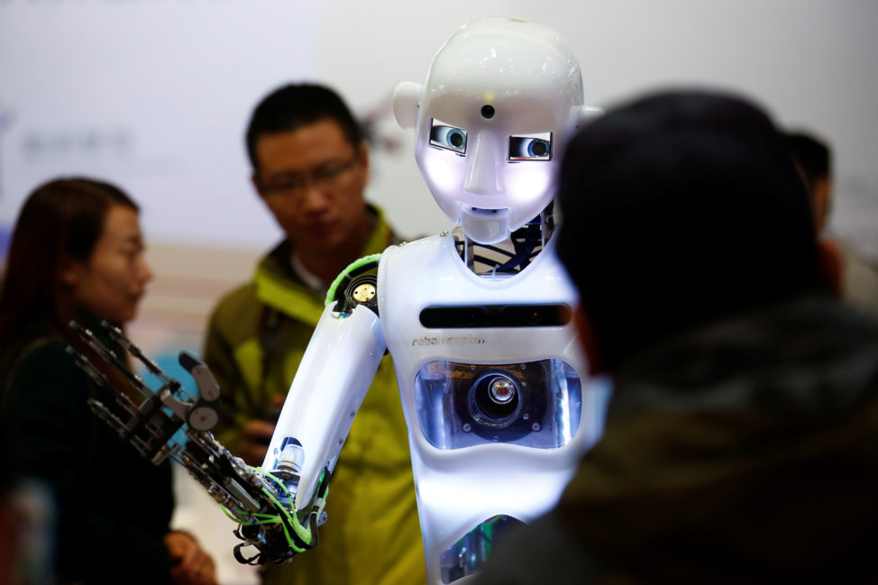 FILE: People look at a RoboThespian humanoid robot at the Tami Intelligence Technology stall at the WRC 2016 World Robot Conference in Beijing, China, Oct. 21, 2016.