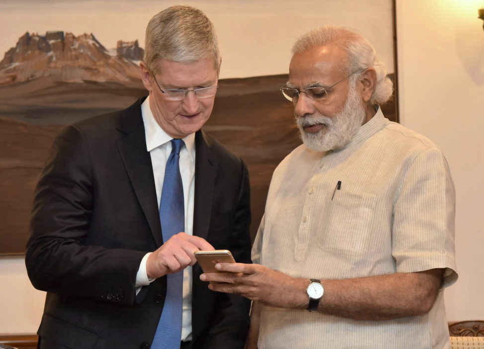 FILE - A hoto released by the Press Information Bureau of India, Indian Prime Minister Narendra Modi (R) as he meets with Apple CEO Tim Cook, in New Delhi, India, Saturday, May 21, 2016. (AP)