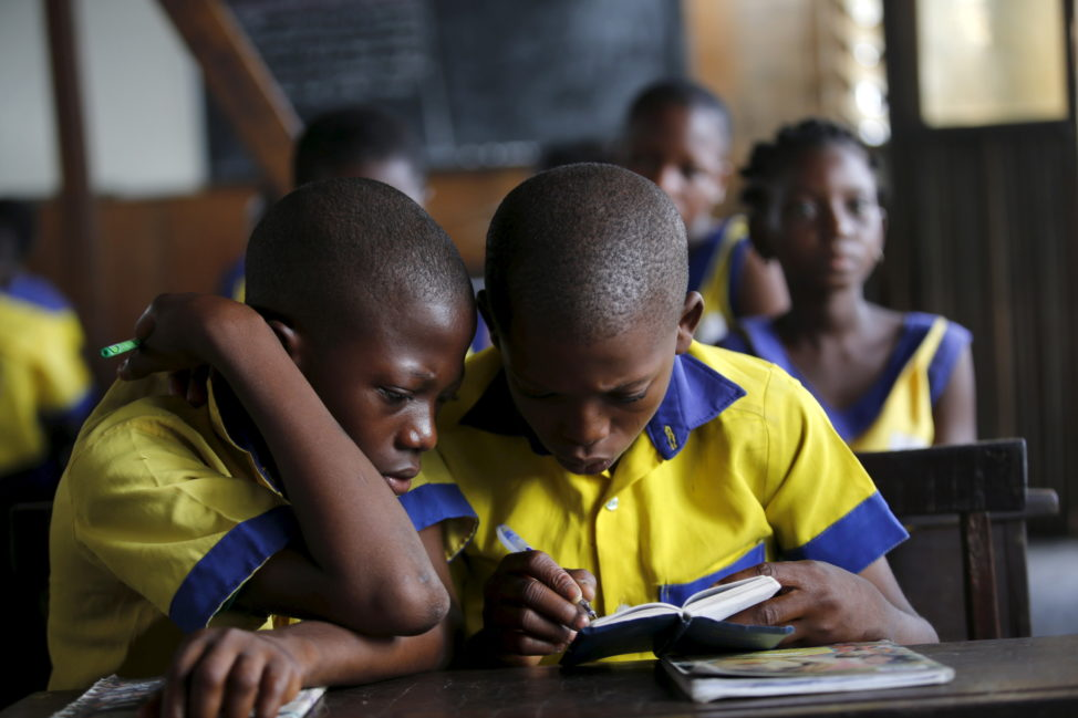 Students read a book at the Makoko floating school on the Lagos Lagoon, Nigeria Feb. 29, 2016. (Reuters)
