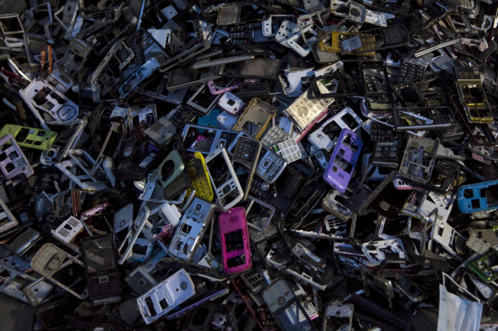 FILE - Old cellular phone components are discarded inside a workshop in the township of Guiyu in China's southern Guangdong province June 10, 2015. (Reuters)