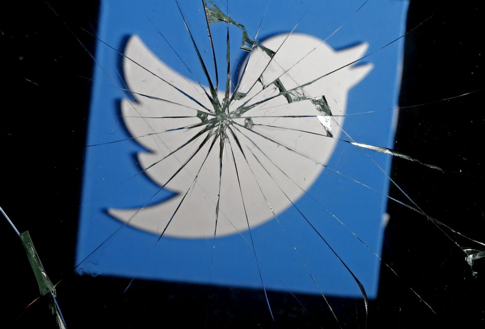 FILE - A picture illustration shows a 3-D-printed Twitter logo through broken glass. (Reuters)