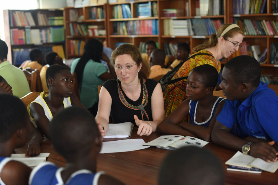An IBM Corporate Services Crops member talks to young girls in a village in Ghana. (IBM Corporation)