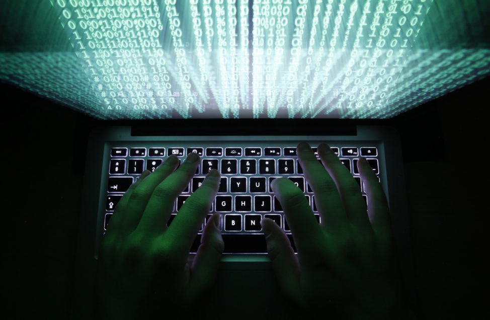 FILE - An illustrations shows a man typing on a computer keyboard in Warsaw, Poland. (Reuters)