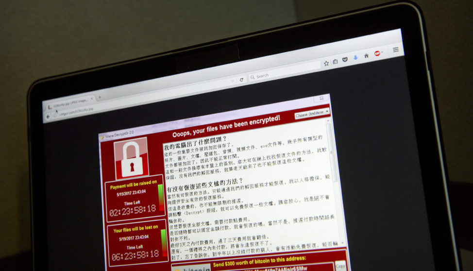A screenshot of the warning screen from a purported ransomware attack, as captured by a computer user in Taiwan, is seen on laptop in Beijing, China, May 13, 2017. (AP)