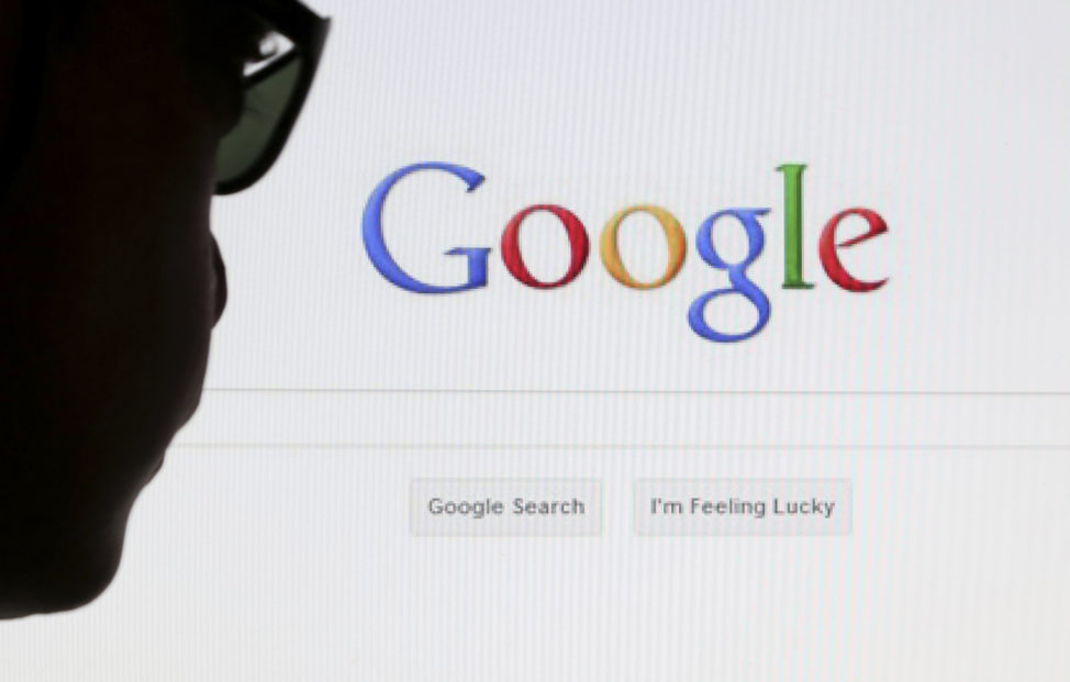 FILE - A computer user poses in front of a Google search page in this photo illustration taken in Brussels, Belgium. (Reuters)