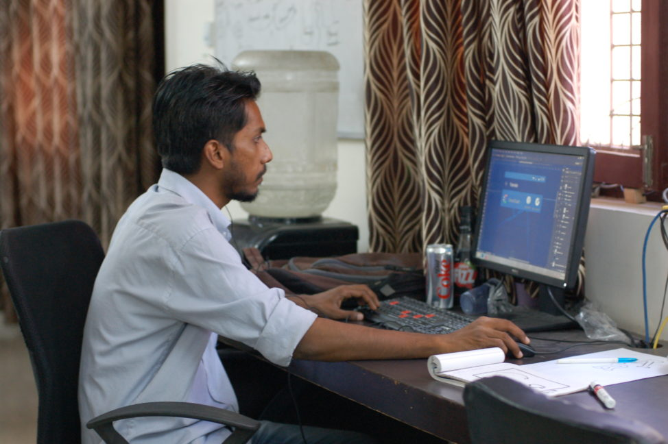 Amit Ratnakar, Crowdtect UI Designer, works on the CrowdGuard app interface, in West Delhi, India. (CrowdGuard)