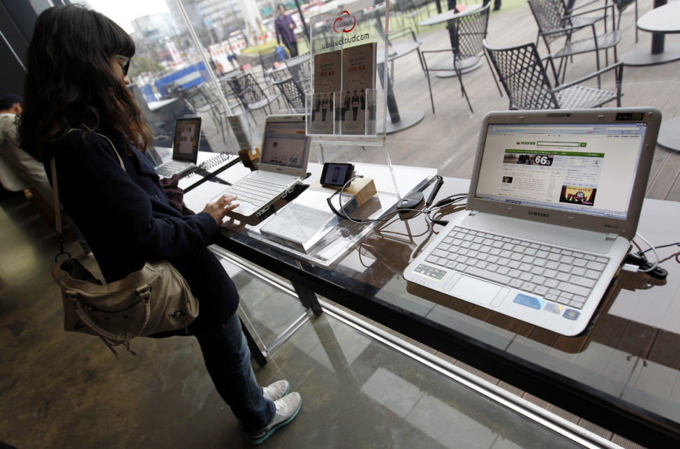 FILE - A woman surfs the Internet on a computer for visitors in Seoul, South Korea. (Reuters)