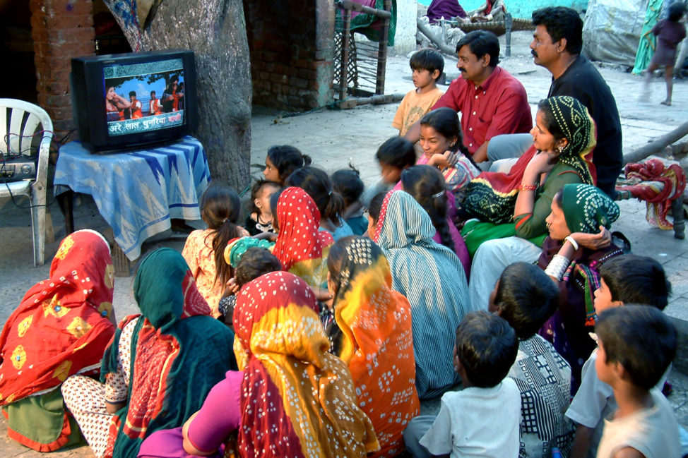 Members of the community view songs with Same Language Subtitling at the Gulbai Tekra Slum in Ahmedabad, India. (Jaydeep Bhatt)