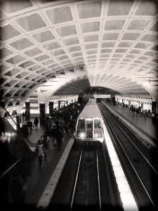 The crowd on the left is about to board a Washington subway.  Poor souls.  Some of them are actually hoping they'll find seats unoccupied by people, purses, and other riders' feet.  (laffy4k, Flickr Creative Commons)