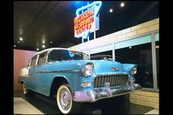 "The ""good life"" depicted in the Johnson County Museum's exhibit on suburbia, certainly included a nice car like this 1955 Chevy Bel-Air, and a convenient shopping center. (Johnson County Museum)"