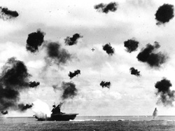 "On June 4, 1942, during the ""Battle of Midway,"" the USS aircraft carrier ""Yorktown"" was blasted by Japanese aerial torpedoes.  Listing badly, she was abandoned but stayed afloat until a Japanese sub sent her to the bottom with two more torpedo strikes."
