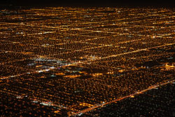 Do you want a handy image of suburban sprawl? These are just some of Chicago's suburbs, photographed from an airplane that was departing O'Hare Airport at night. (San Diego Shooter, Flickr Creative Commons)