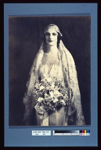 "I can feel pretty safe in saying that this bride had no qualms about taking her husband's name.  It was the ""way things are done"" back then.  (Library of Congress)"