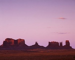 The magnificent rock formations of Monument Valley within the Navajo Nation in Arizona turn a succession of enchanting colors at sunset.  (Carol M. Highsmith)
