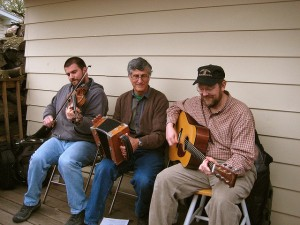 "This is the ""Cajun Strangers"" band between gigs. The middle fellow is playing the ""squeezebox,"" a single-row accordion that's lighter and simpler to play than the full accordion you might hear in a German polka band. (psforsberg, Flickr Creative Commons)"