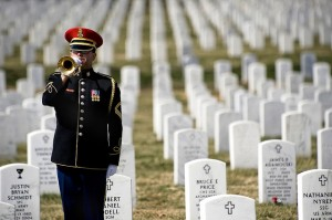 "A bugler sounds ""Taps"" during a burial ceremony at Arlington.  (Beverly & Pack, Flickr Creative Commons)"