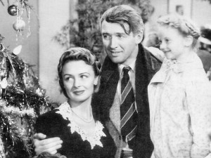 "James Stewart as George Bailey — with Donna Reed as his wife, Mary, and Karolyn Grimes as his youngest child, Zulu — still looks frazzled, despite the happy ending to ""It's a Wonderful Life.""  (Seneca Falls It's a Wonderful Life Museum)"