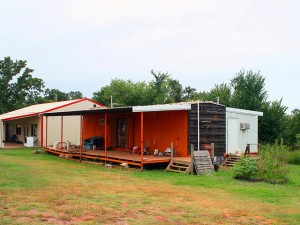 "Talk about creative.  A combination house trailer and railroad car made into a double-wide! (Chuck ""Caveman"" Coker, Flickr Creative Commons)"