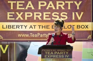 "Former U.S. vice presidential candidate speaks at the kickoff of her ""Tea Party Express"" bus tour in October.  Not sure what the ""IV"" is for. (AP Photo)"