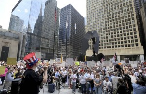 A speaker invokes Uncle Sam at a Tea Party Rally in downtown Chicago in April.  (AP Photo)