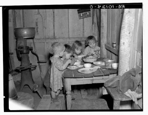 This Christmas dinner, in the Pauley family's house near Smithfield, Iowa, was anything BUT elegant.  It consisted of potatoes, cabbage, and a pie.  (Library of Congress)