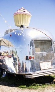 "Airstreams and motor homes are often put to ""adaptive reuse.""  This one is now the home of a cupcake-sales operation.  (B*2, Flickr Creative Commons)"