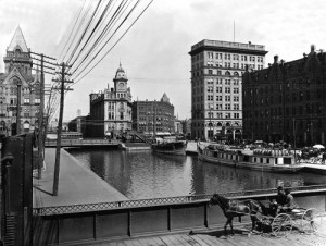 A horsecart passes over the much more successful Erie Canal in Syracuse, New York, about 1900.  (Library of Congress)