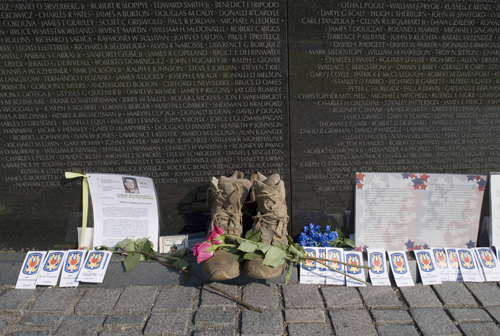 Many decades after the conclusion of the Vietnam War, people are still leaving small tributes at the Vietnam Veterans Memorial.  (Carol M. Highsmith)