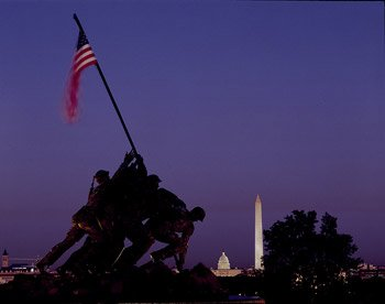 "The U.S. Capitol and Washington Monument gleam in the distance after sunset, across the Potomac River from the powerful Marine Corps War Memorial that depicts the raising of the U.S. colors in the heat of battle on the ""sands of Iwo Jima"" island in the Pacific in 1945.  (Carol M. Highsmith)"