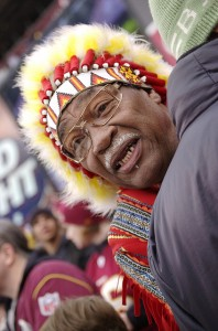 "Columnist Malloy, a black man like the Redskins' ""unofficial"" mascot, Zema ""Chief Zee"" Williams, has written that the ""Chief"" should think about the appropriateness of his actions.  (JAGalicious, Flickr Creative Commons)"