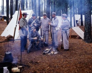 "Civil War re-enactments like this one in North Carolina certainly honor the courage of the soldiers on both sides.  These ""Confederates"" gather beside a campfire.  (Carol M. Highsmith)"