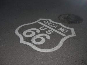 We associate historic U.S. Route 66 with the American heartland.  And the nation's population mean center is already past this pavement sign near Rolla, Missouri.  (jimmywayne, Flickr Creative Commons)