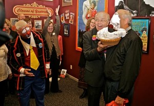Greg DeSanto, out of costume but ever the cut-up, delivers a face-pie at the grand re-opening of the clown museum.  (ICHOF)