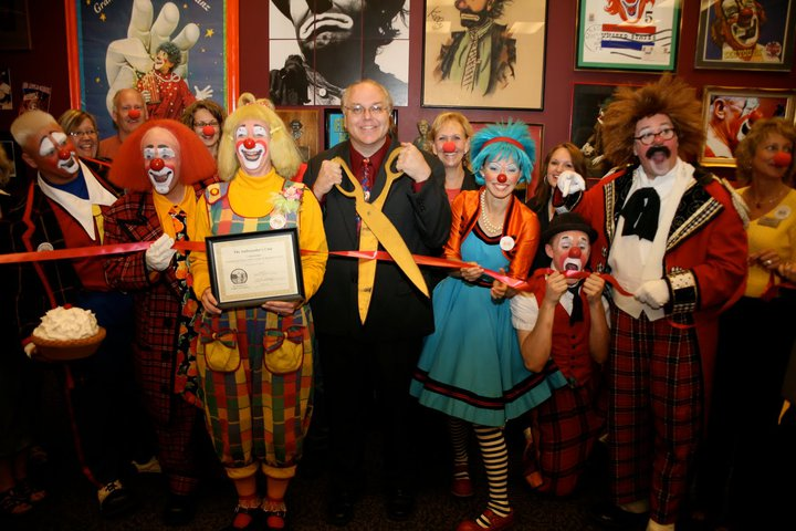Greg and more colorful clowns goof off during the ribbon-cutting.  (ICHOF)