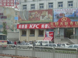 "Do the people of Beijing ""dig"" KFC's ""Colonel"" Harlan Sanders? I wonder.  (puuikibeach, Flickr Creative Commons)"