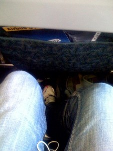 Just crossing your legs in a middle seat is out of the question.  You might never be able to uncross them. (schatz, Flickr Creative Commons)