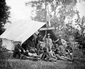 "Union soldiers relax near an assistant quartermaster's ""office"" in the field.  (Library of Congress)"