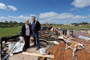 David and Sharon Newton stand stop what little is left of their home in Concord, Alabama, after one of this Spring's killer storms leveled it.  (Wynter Byrd/AP)