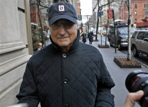 Convicted investment swindler Bernard Madoff managed a thin smile here, but certainly made a lot of other people mighty UNhappy.  (Jason De Crow/AP)